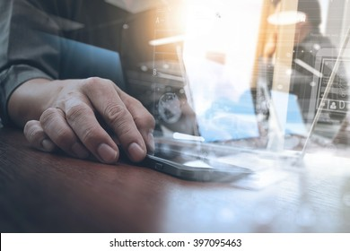 business man hand working on digital tablet computer and smart phone with layer strategy and social media diagram on wooden desk