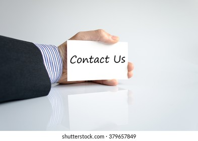Business man hand writing contact us