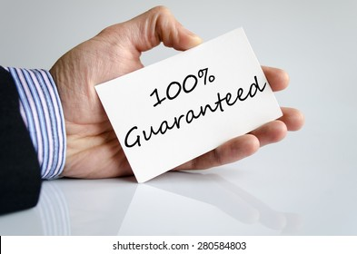 Business man hand writing Guaranteed