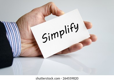 Business man hand writing Simplify - business concept