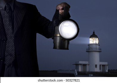 business man handing the lamp in darkness