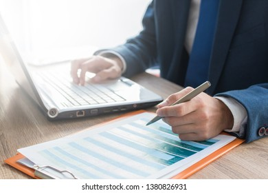 business man hands with computer on desktop