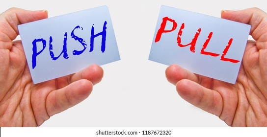 business man hands handling cards with push pull words
