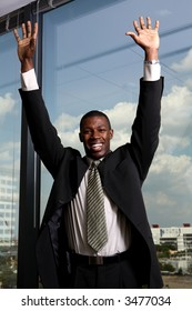 business man with hands up happy