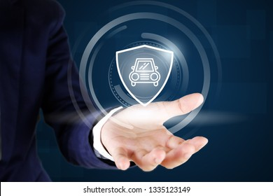 Business man hands holding car and shield icon , car insurance concept