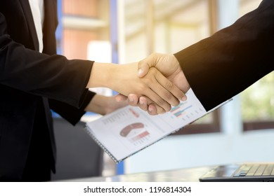 Business man Handshaking Business women, About with working, Happy with success Agreed to work, Handshake Business Marketing in graph Concept.Foreign Investors Success in business together.