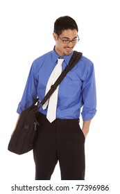 A business man has a bag on his shoulder and is looking down.