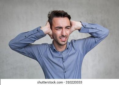 business man has headache cause of din