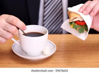 Business man having a breakfast