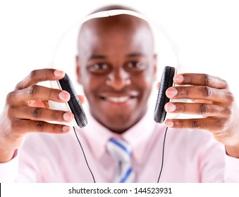 Business man with headphones - isolated over white