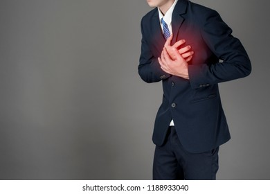 Business man is heart attack  ,grey background in studio