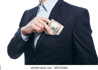 Business man hiding money in pocket on white background