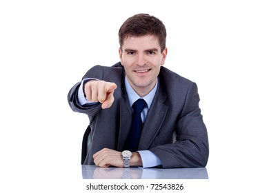 business man at his desk pointing , on a white background