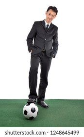 Business man and his leather ball.