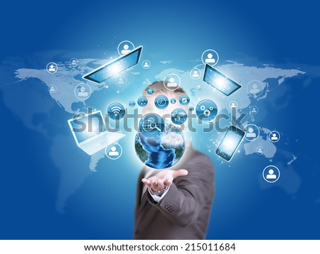 Business man hold Earth globe and electronics in hand
