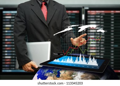 Business man hold laptop and graph report : Elements of this image furnished by NASA