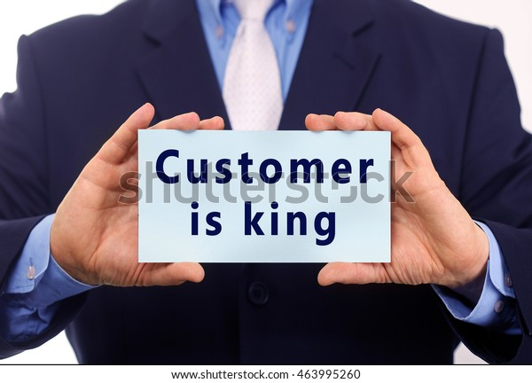 Business man hold paper customer is king text on it