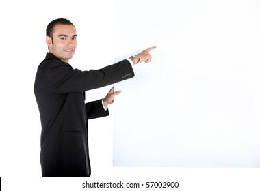 Business man holding a banner - isolated over a white background