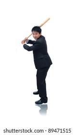 Business man holding baseball bat ready for a hit