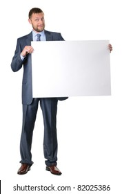 Business man holding a blank banner isolated on white background
