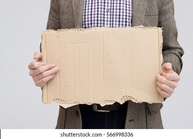 Business man holding up blank cardboard sign