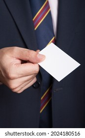 Business man holding a blank empty business card with isolated white screen. Businessman presenting his business card