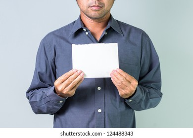 Business man  holding blank paper