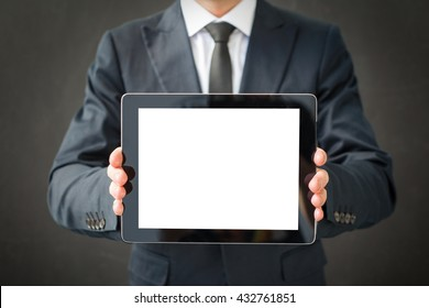 Business man holding blank screen tablet