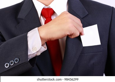 business man holding blank white card within his pocket