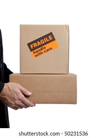 Business man holding a brown corrugated, cardboard moving box on white with copy space