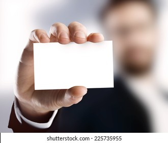 Business man holding card