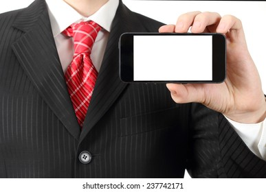 Business man holding a cell phone, close-up