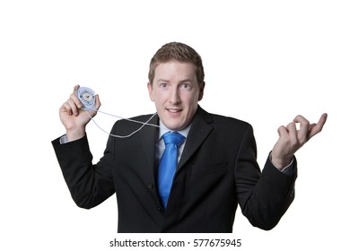 business man holding a compass unsure what way to go