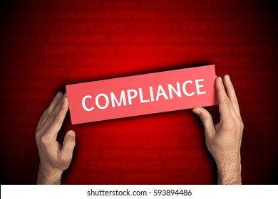 Business man holding Compliance sing
