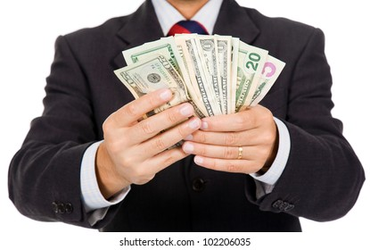 Business man holding dollar bills, isolated on white