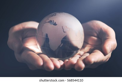 Business man holding Earth planet in palm