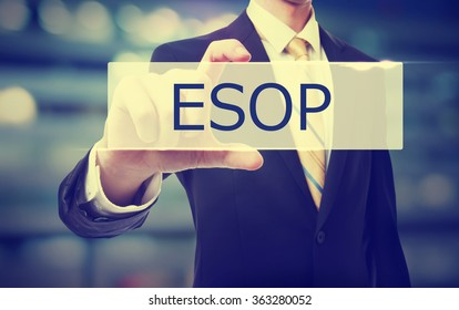 Business man holding ESOP on blurred abstract background