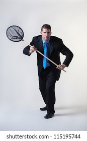 business man holding a fishing net trying to find and catch new business
