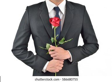 A business man holding flowers Beautiful red roses on a white background.