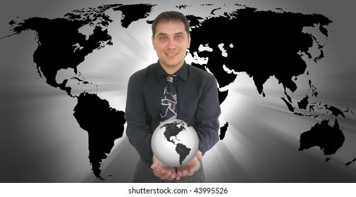 A business man is holding a globe of the Earth in his hands. There is a black and white color scheme.