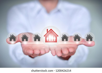 Business man holding house icon, character home ownership concept creative illustration