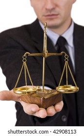 A business man holding a justice scale, isolated in white background