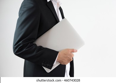 Business man holding  laptop
