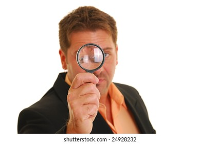 Business man holding a magnifying glass isolated on white. focus on hand and magnifying glass.
