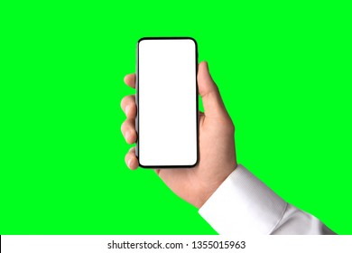 Business man holding modern edge to edge smartphone, blank screen, greenscreen background template, isolated
