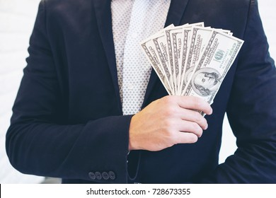 business man  holding money dollar bills , concept for success business