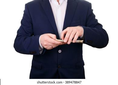 business man holding money, isolated on white
