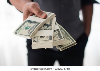 Business man holding money on white background. Concept of finance success.