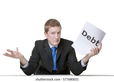 business man holding a paper sign with the world debt written on it looking unhappy