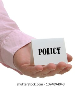 Business man holding policy sign on hand